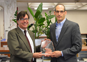 Joe Lucia, University Librarian and Steve Bell, ACRL President, show off the ACRL award.
