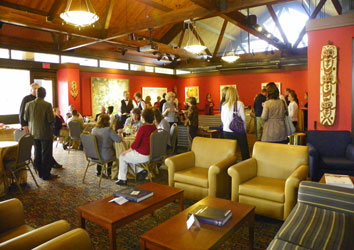 Falvey Library staff gathers in the President's Lounge for Father Peter's reception.