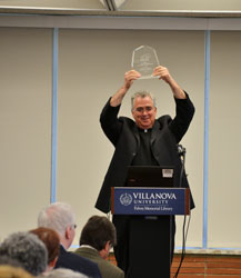 Fr. Peter Donohue displays the ACRL award.