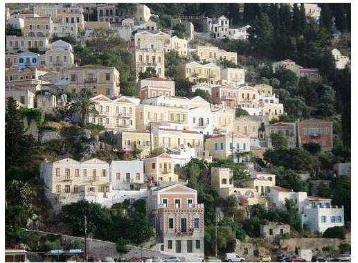 Barbara Quintiliano, Nursing & Life Sciences liaison and Instructional Services librarian, visited a few Greek islands. Pictured here are pastel building facades on Symi Island.