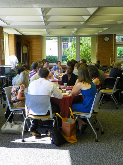New faculty and Falvey staff enjoy breakfast and conversation.