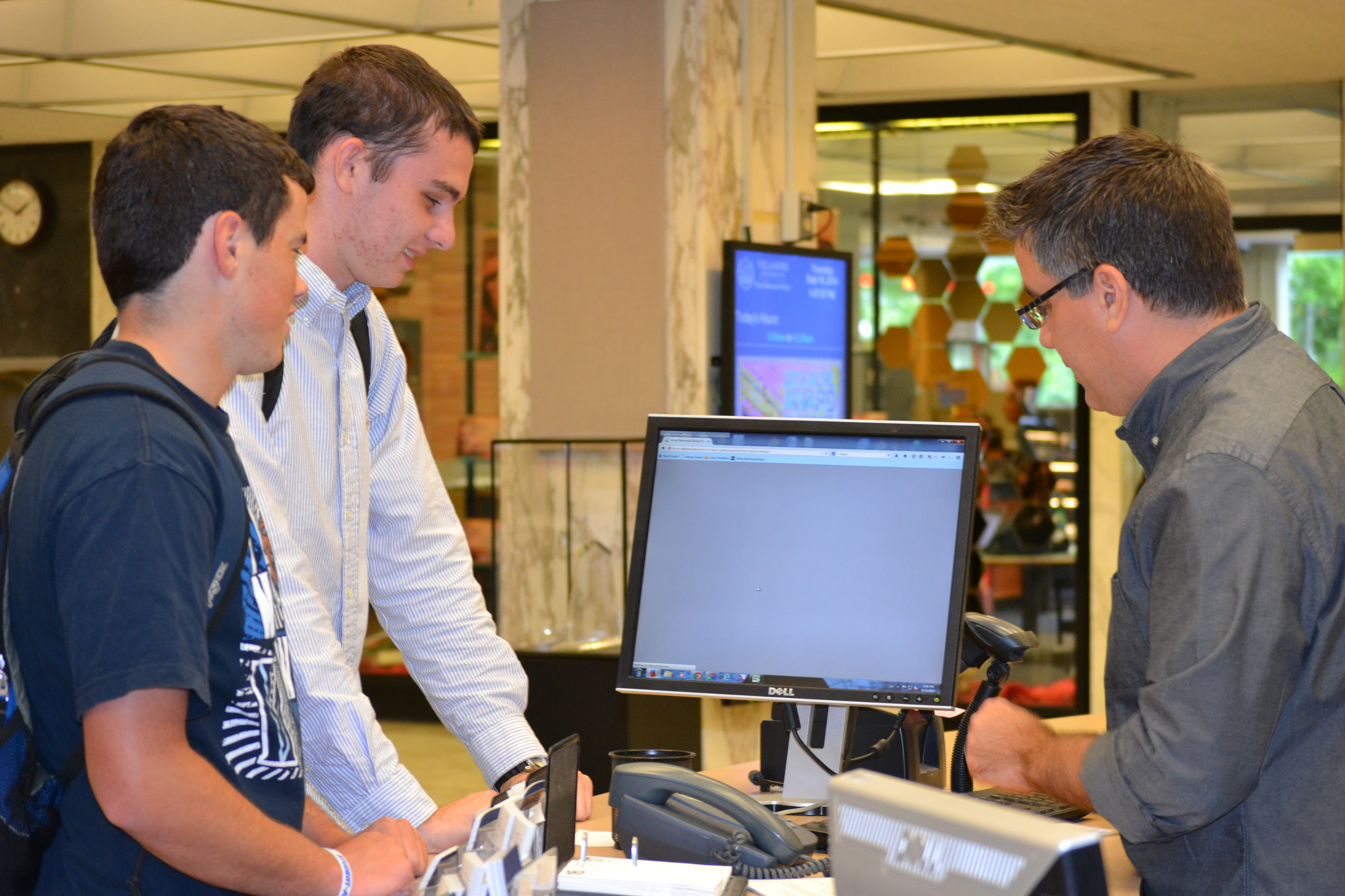 Librarian Rob LeBlanc, right, works with first year students Conor Quinn and Steve