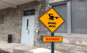 Students are warned to watch overhead for the book delivery drones, particularly on windy days.