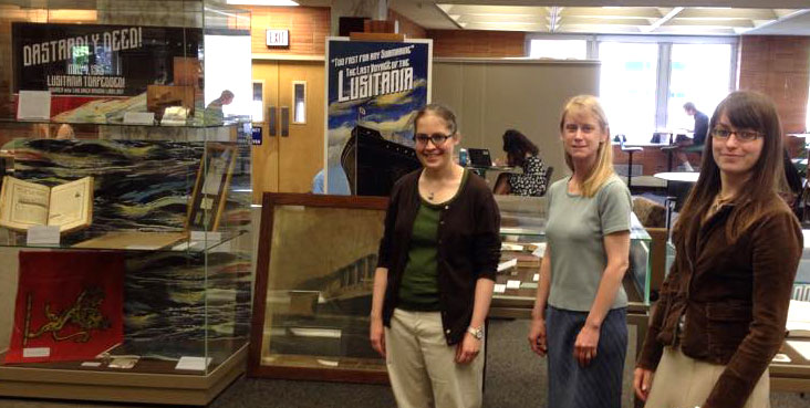 Installing the Lusitania exhibit are  (l-r): Laura Bang, Alison Dolbier and Marjory Haines.
