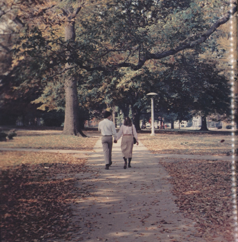 Two students holding hands on Villanova's campus- 1980