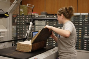 Student scanning the King James Bible.