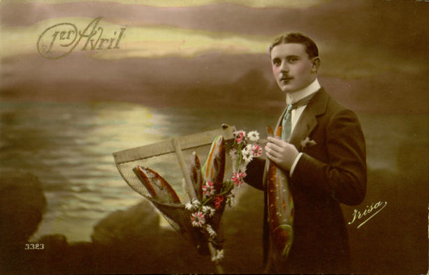 "A late-19th-century ""April fish"" postcard depicting a man by the sea with a bouquet of fish."