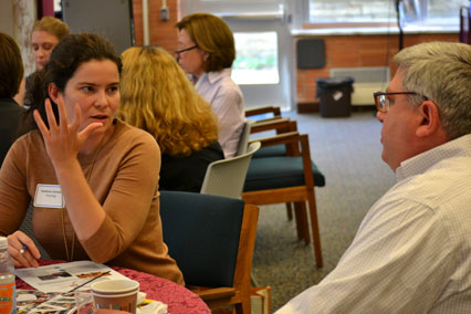 Darren Poley, liaison to the Theology department, talks with new faculty member Kathleen Grimes.