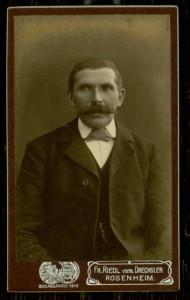 Riedl vorm. Dreschler, Man with large mustache.