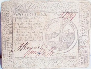 a United Colonies $2 bill from 1775 [public domain]