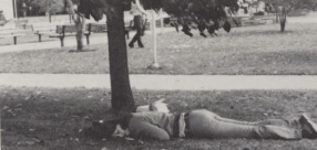Student relaxing under a tree--from the 1975 yearbook