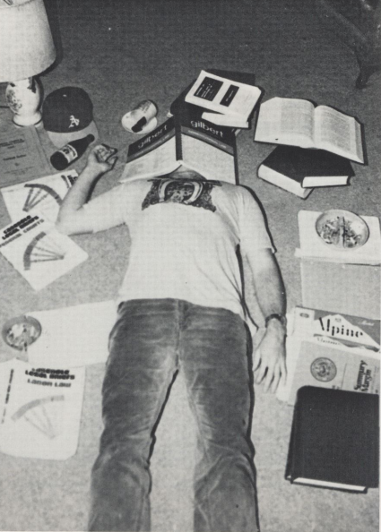 Student studying--a bit too hard! From the 1980 yearbook