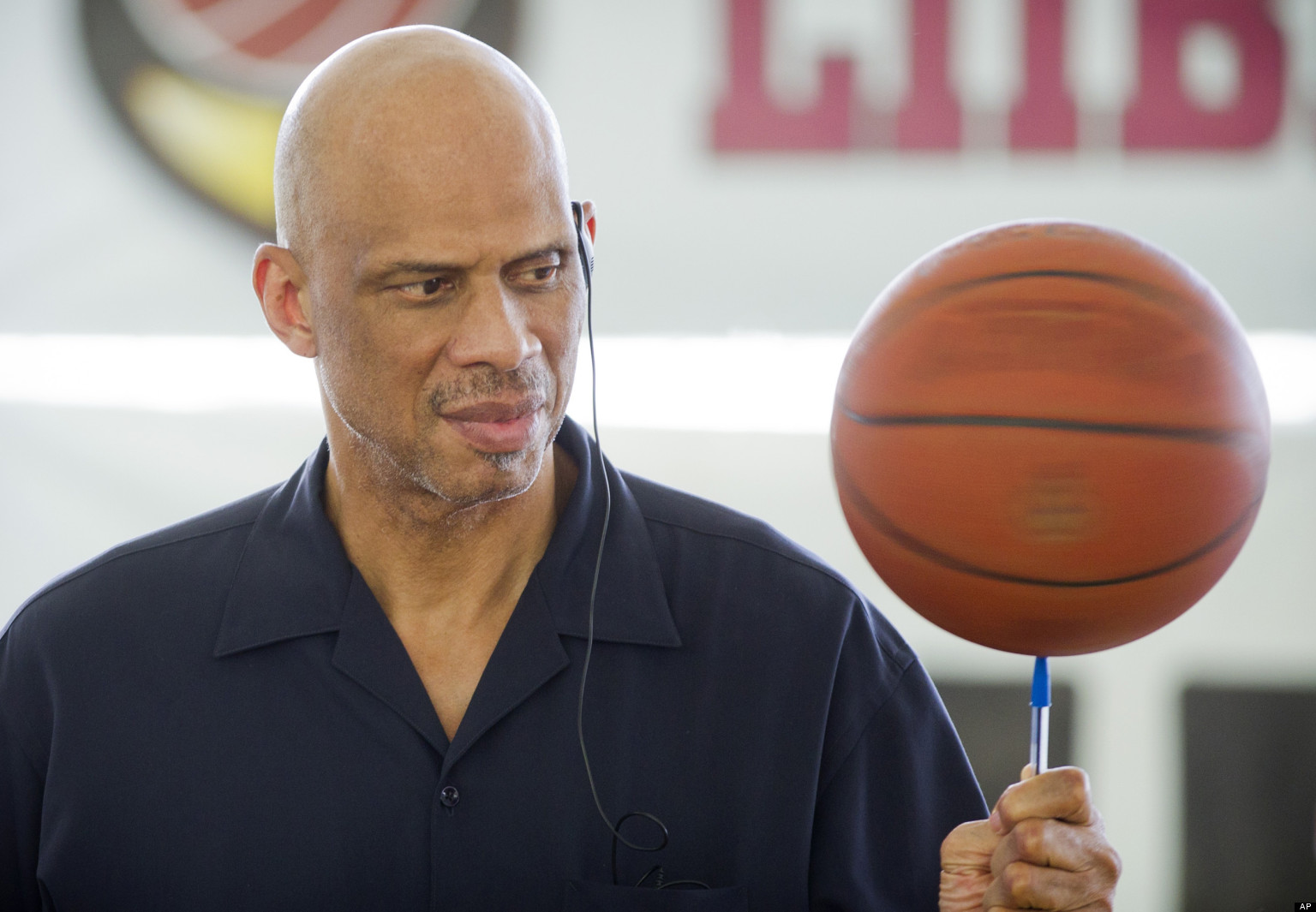 kareem abdul-jabbar spins a basketball atop his pen