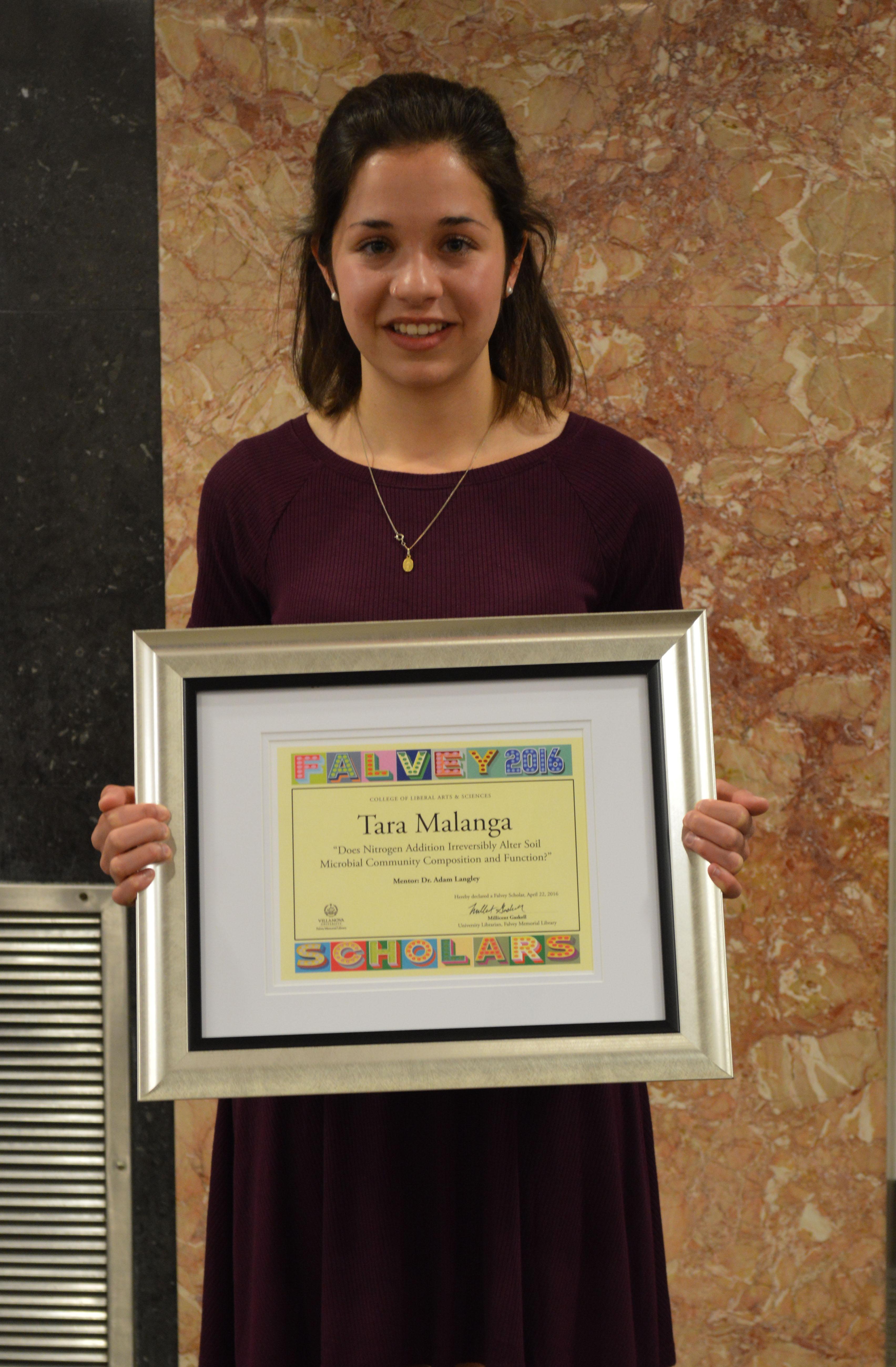 Tara Malanga with Falvey Scholars certificate