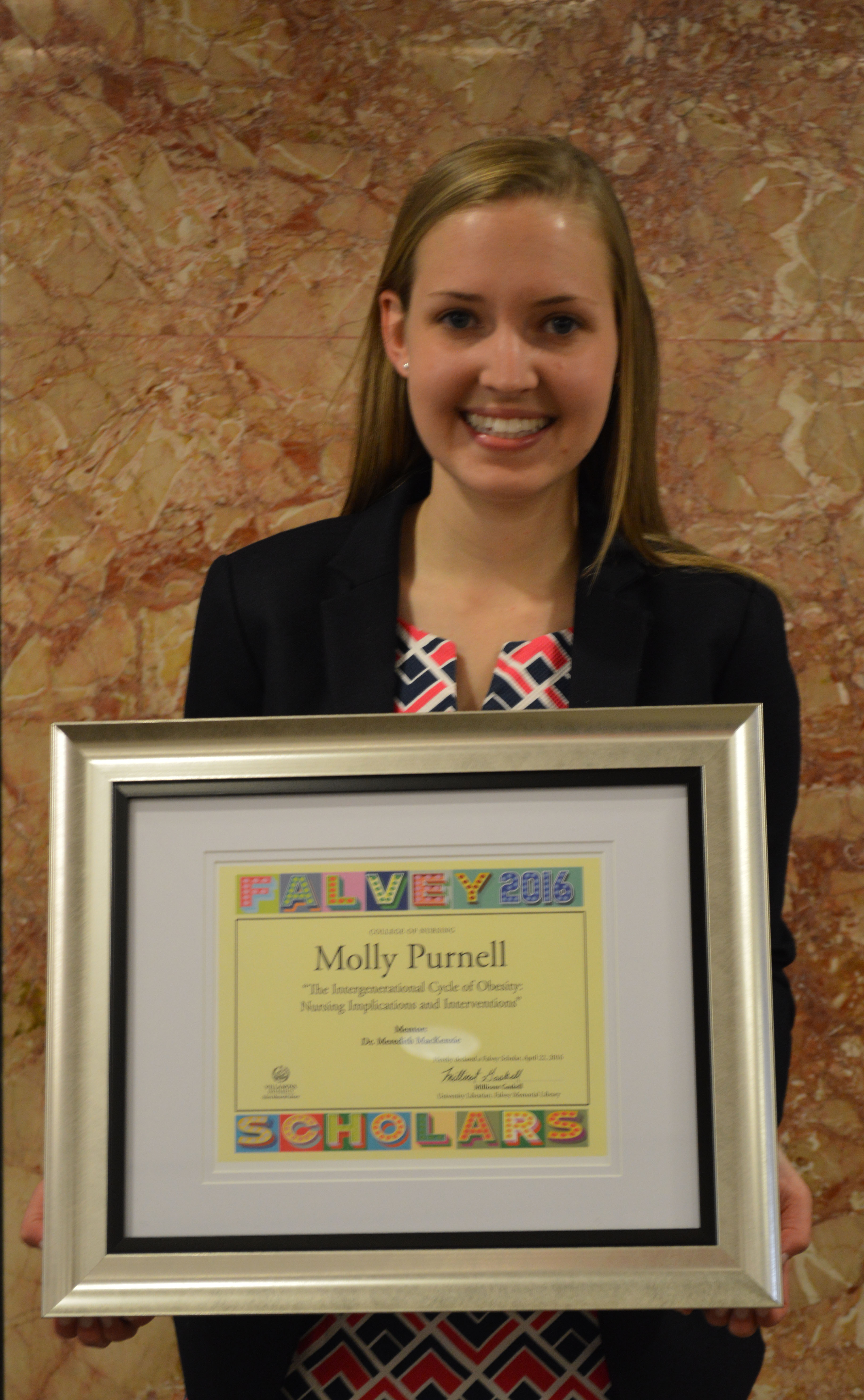 Falvey Scholar Molly Purnell with certificate