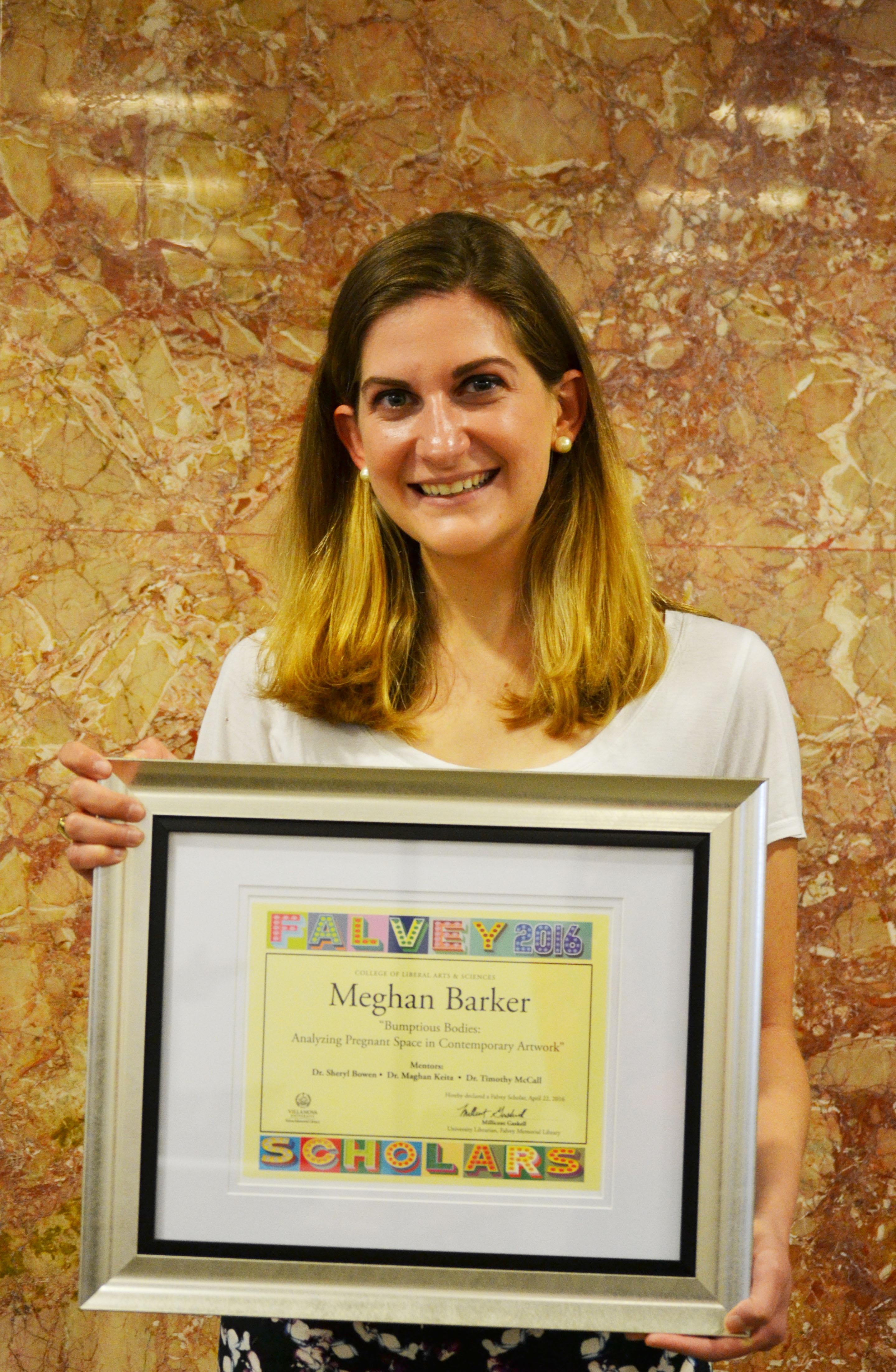 Meghan Barker holding Falvey Scholars Certificate