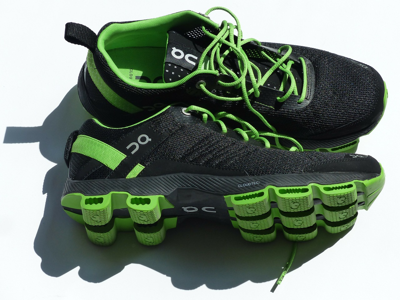 a pair of green and black running sneakers
