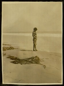 Unidentified woman on a beach, 1919.