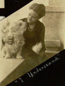 Photo of woman and dog staring at each other