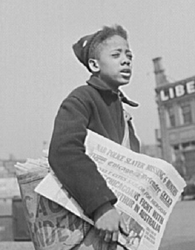 Newsboy selling the Chicago Defender, one of the papers in the Black Newspaper Collection