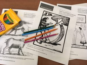 Photo of coloring pages and colored pencils.
