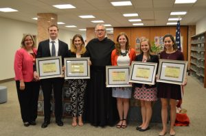The 2016 Falvey Scholars pictured with University President, the Rev. Peter M. Donohue, OSA, PhD.