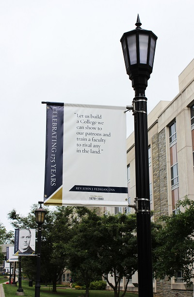 "Photo of banner: ""Let us build a College we can show to our patrons and train a faculty to rival any in the land."" Rev.Fedigan, 11th Villanova president"