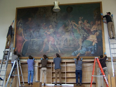 Photograph of painting being removed from wall
