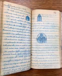 Photo of a two-page spread of a travel diary, with handwriting and small drawings of architectural details in blue ink.