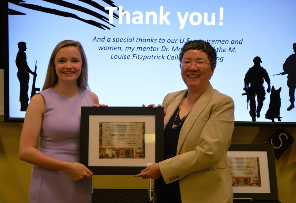 "Erin Donnelly receives the Falvey Scholar Award from Associate University Librarian for Collections and Stewardship Jeehyun ""Jee"" Davis."