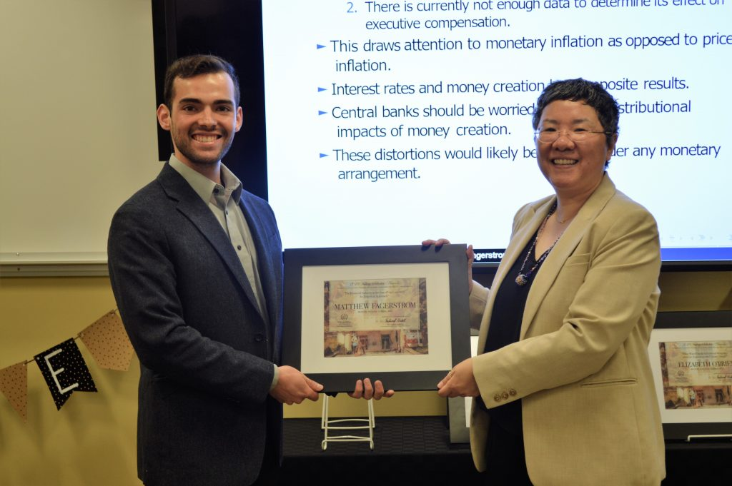 "Matthew Fagerstrom receives the Falvey Scholar Award from Jeehyun ""Jee"" Davis, Associate University Librarian for Collections and Stewardship."