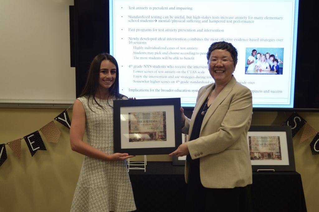 "Erica Ferrara receives the Falvey Scholar Award from Jeehyun ""Jee"" Davis, Associate University Librarian for Collections and Stewardship."