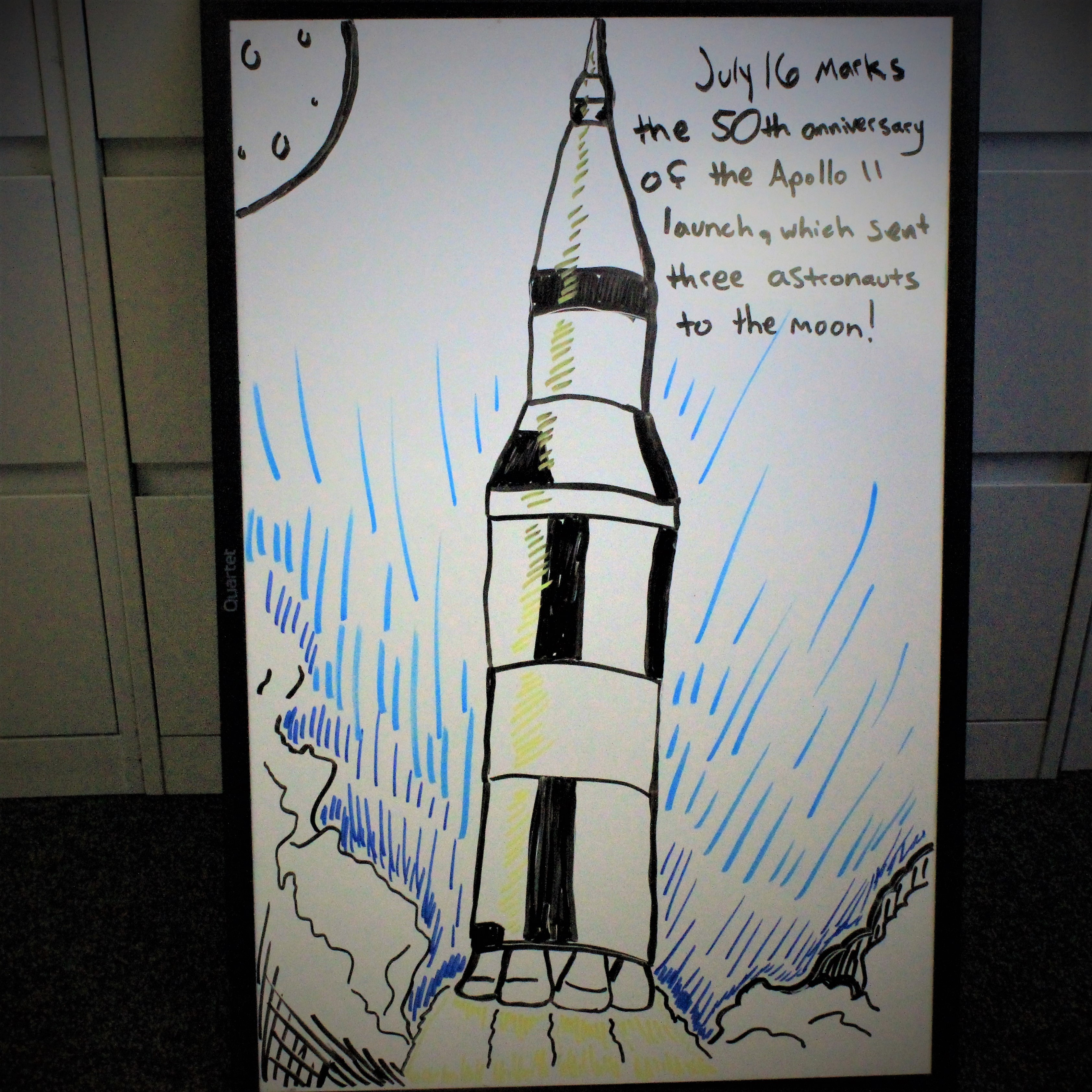 A white board drawing of the Apollo 11 launch.