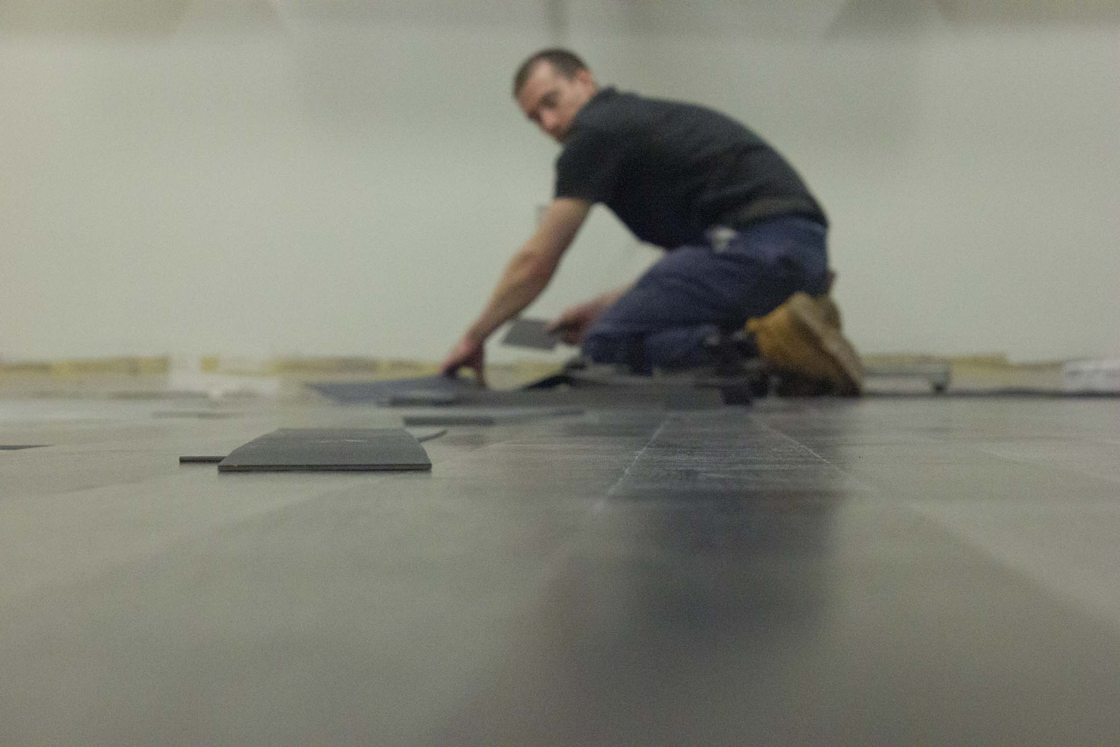 a worker installs the floor