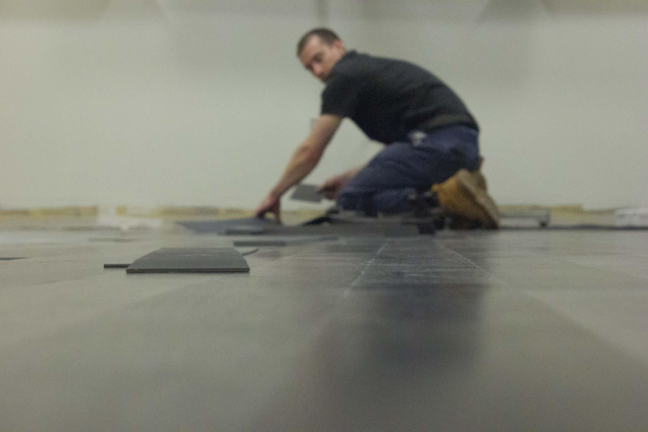 a worker installs the floor