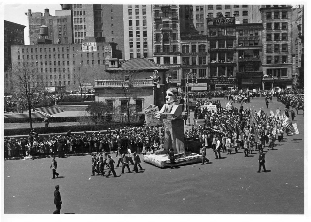 "Image of the ""Daily Worker"" float makes its way through New York streets in the 1937 May Day parade."