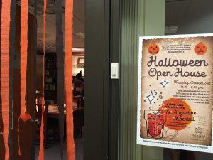 Halloween event sign next to the door.