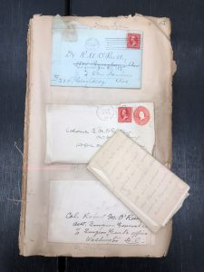 A page of the O'Reilly Scrapbook with a letter pulled out.