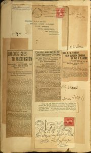 A page of O'Reilly Scrapbook. Includes newspaper articles and envelopes.