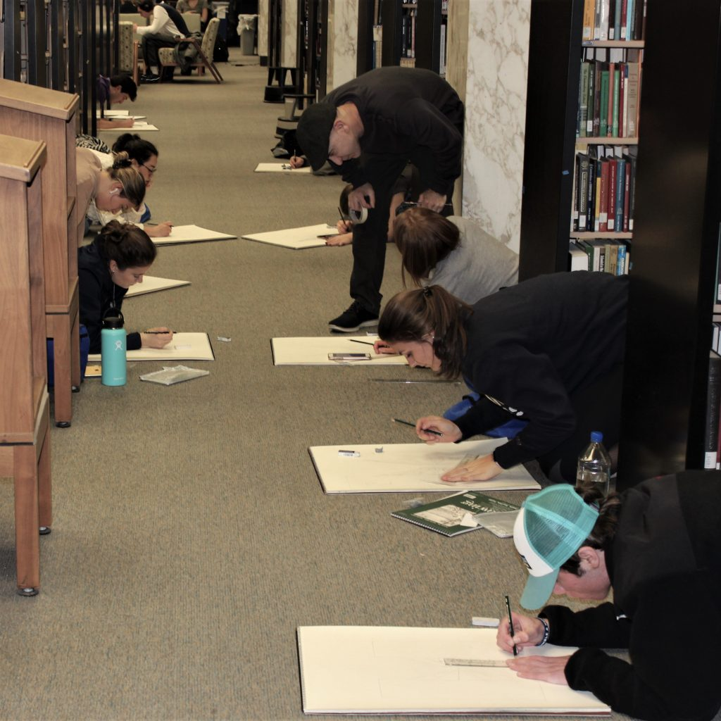Students Drawing in the Stacks