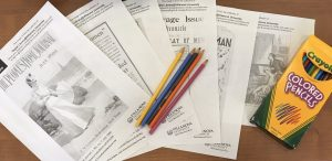 Coloring pages and colored pencils.