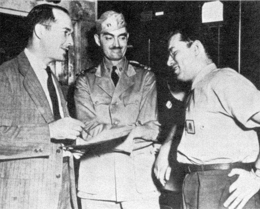 Robert Heinlein, L. Sprague de Camp and Isaac Asimov, at the Philadelphia Navy Yard in 1944.