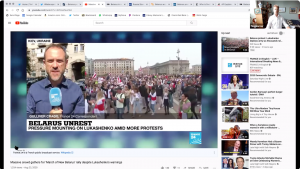 screenshot of a video showing the protests in Belarus and a reporter covering it