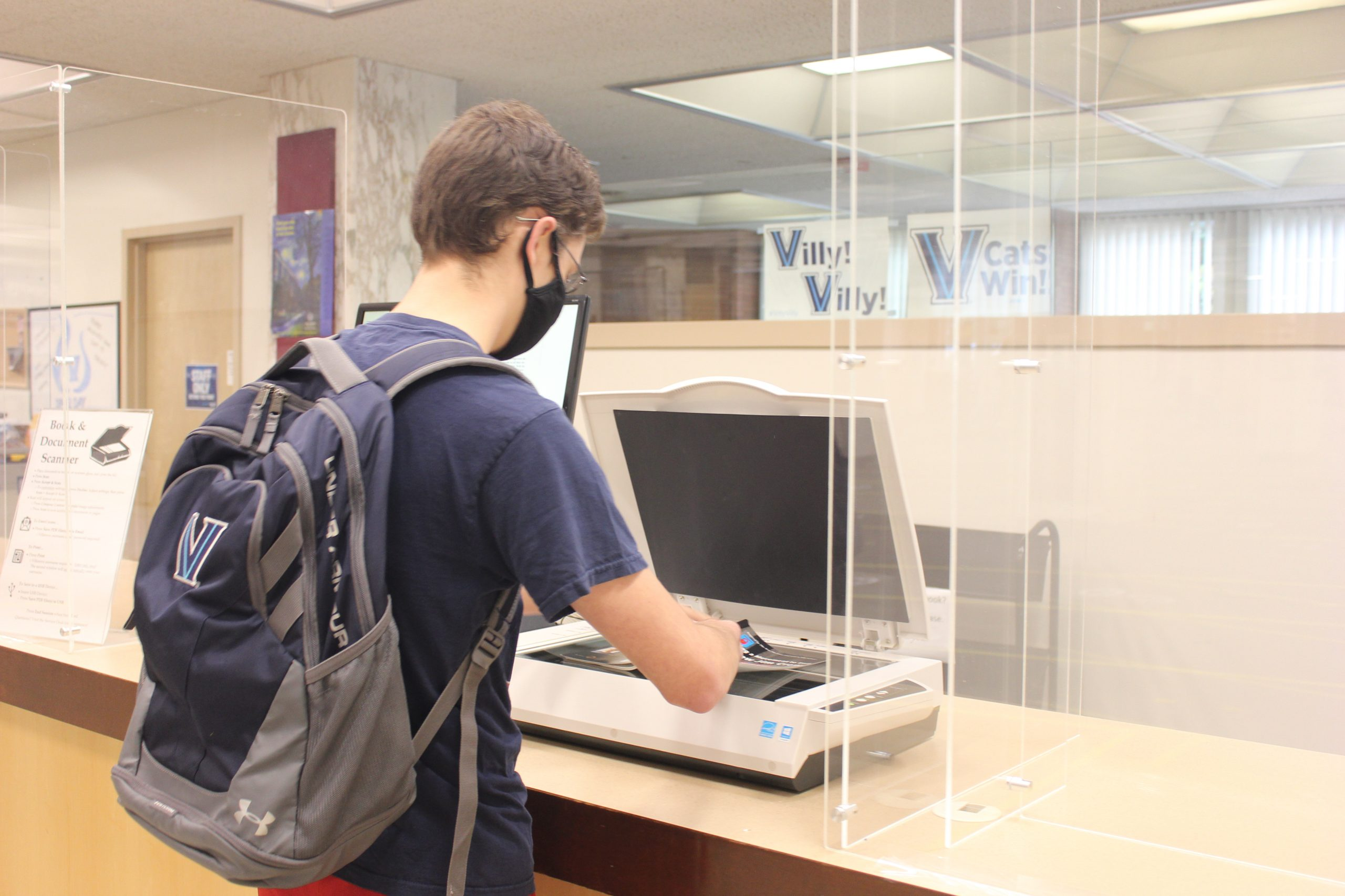 Picture of Villanova student using the KIC scanner.