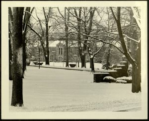 Campus, Snow scene with view of Grotto and Chemical Engineering Building, 1970