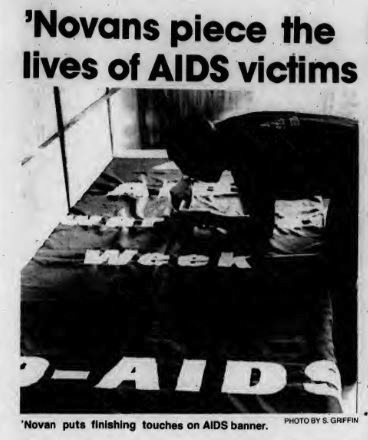 Student works on AIDS banner