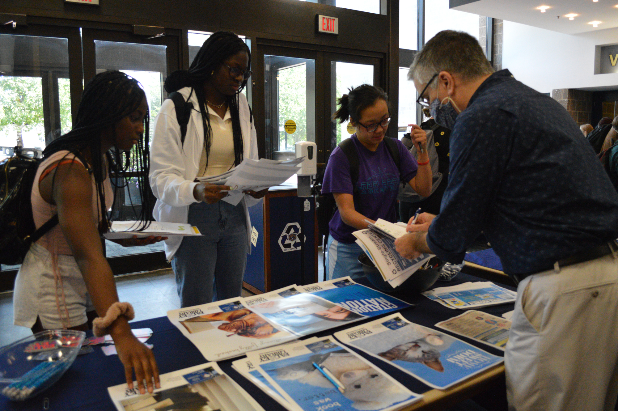 Students meet with Library staff at the RA Fair.