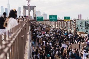 """""""protesters crowd the streets in the wake of George Floyd's murder"""""""